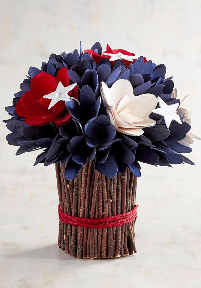 "<p>$19</p><p><a rel=""nofollow"" href=""https://www.pier1.com/patriotic-flowers-wood-curl-arrangement/3319640.html"">SHOP NOW</a></p><p>Made from bamboo and paper, this flower arrangement makes the perfect centerpiece for your 4th of July table. </p>"