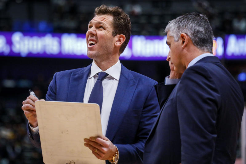 Sacramento Kings coach Luke Walton, left, looks at the scoreboard during a timeout in the first half of an NBA basketball game against the Denver Nuggets, Sunday, Dec. 29, 2019 in Denver. (AP Photo/Joe Mahoney)