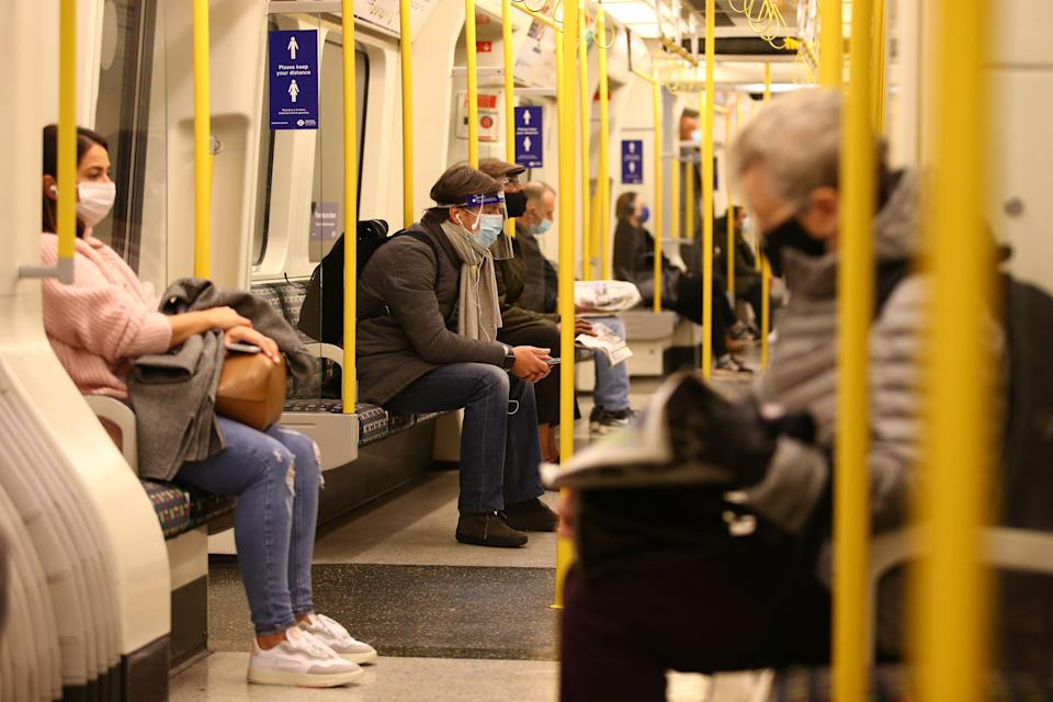Commuters sit on a District line train on the London underground as England enters a second coronavirus lockdown on November 5, 2020. (Photo by Hollie Adams / AFP) (Photo by HOLLIE ADAMS/AFP via Getty Images)