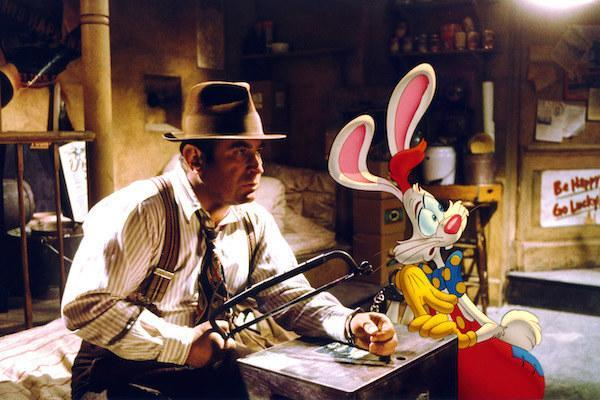 Bob Hoskins and Roger Rabbit (voiced by Charles Fleischer) trying to break out of handcuffs.