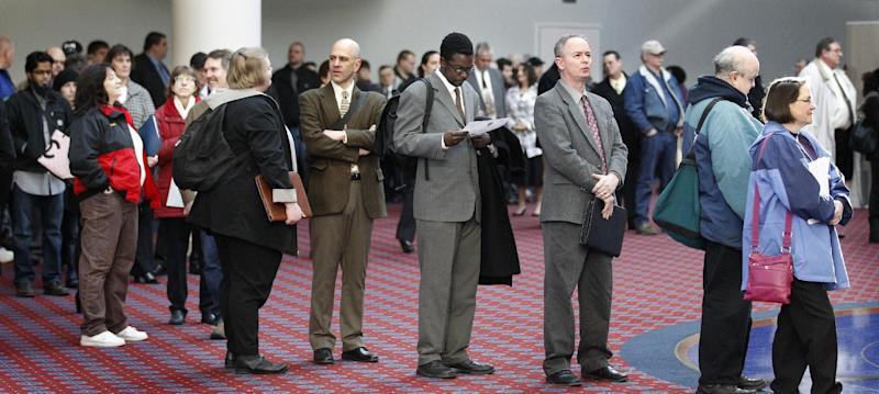FILE - In this March 7, 2012, file photo shows job seekers standing line during the Career Expo job fair, in Portland, Ore.  Employers pulled back sharply on hiring last month, a reminder that the U.S. economy may not be growing fast enough to sustain robust job growth. The unemployment rate dipped, but mostly because more Americans stopped looking for work.  The Labor Department says the economy added 120,000 jobs in March, down from more than 200,000 in each of the previous three months. (AP Photo/Rick Bowmer)