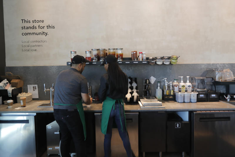 FILE - In this Jan. 16, 2020, file photo baristas prepare drinks at a Starbucks on South Claiborne Ave. in New Orleans. Starbucks Corp. reports financial earns on Tuesday, Jan. 28. (AP Photo/Gerald Herbert, File)