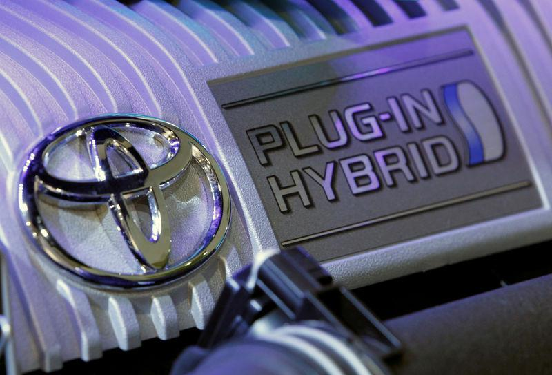 FILE PHOTO : Toyota Motor Corp's logo is pictured on the engine of a plug-in hybrid vehicle displayed at the company's showroom in Tokyo