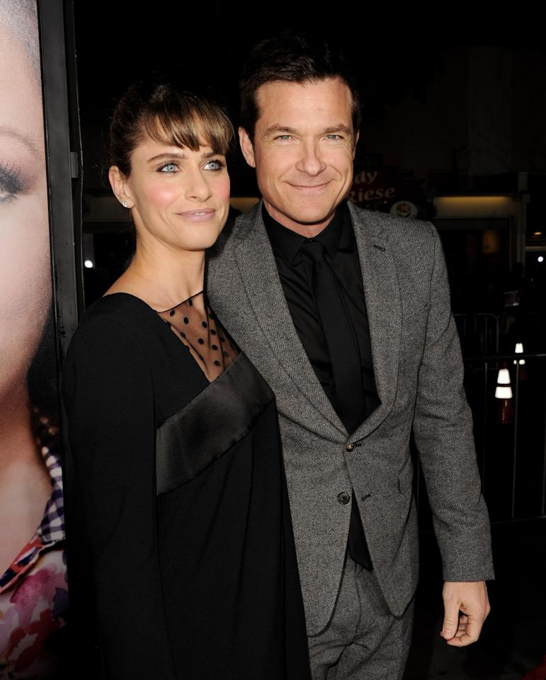 """LOS ANGELES, CA - FEBRUARY 04:  Actress Amanda Peet (L) and actor Jason Bateman arrive at the premiere of Universal Pictures' """"Identity Theft"""" at the Village Theatre on February 4, 2013 in Los Angeles, California.  (Photo by Kevin Winter/Getty Images)"""
