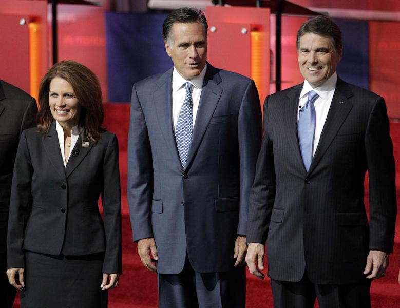 "FILE - In this Sept. 7, 2011, file photo, Republican presidential candidates, from left, Rep. Michele Bachmann, R-Minn., former Massachusetts Gov. Mitt Romney, and Texas Gov. Rick Perry, stand together before a Republican presidential candidate debate at the Reagan Library in Simi Valley, Calif. It's easy to forget there was a time when Bachmann was the surprise breakout from the GOP primary field. To be replaced by Texas Gov. Rick Perry. And then others. Romney pulled the plug on his first presidential run on Feb. 7, 2008, and immediately served notice that he wasn't about to fade away. ""I hate to lose,"" he told conservatives that day. (AP Photo/Jae C. Hong, File)"