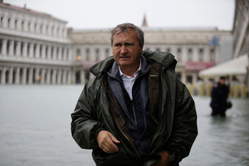 Venice's Mayor Luigi Brugnaro walks in a flooded St. Mark's Square in Venice, Italy, Friday, Nov.15, 2019. The high-water mark hit 187 centimeters (74 inches) late Tuesday, Nov. 12, 2019, meaning more than 85% of the city was flooded. The highest level ever recorded was 194 centimeters (76 inches) during infamous flooding in 1966. (AP Photo/Luca Bruno) (Photo: ASSOCIATED PRESS)