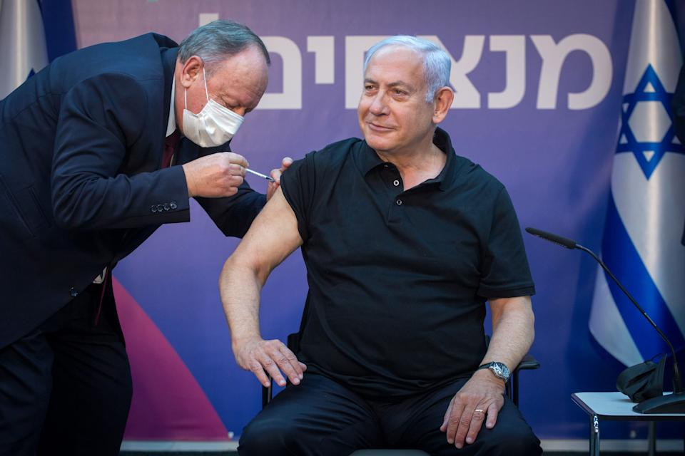 TOPSHOT - Israeli Prime Minister Minister Benjamin Netanyahu receives the second dose of the coronavirus disease (COVID-19) vaccine at Sheba Medical Center in Ramat Gan, near the coastal city of Tel Aviv, on January 9, 2021. (Photo by Miriam ALSTER / POOL / AFP) (Photo by MIRIAM ALSTER/POOL/AFP via Getty Images)