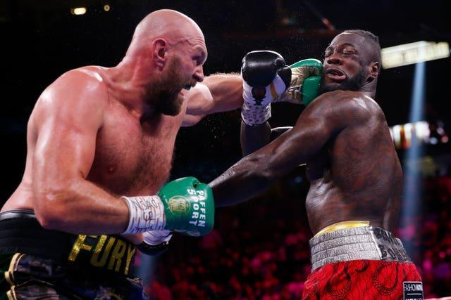 Tyson Fury, left, and Deontay Wilder produced an all-time classic in Las Vegas (Chase Stevens/AP/PA)