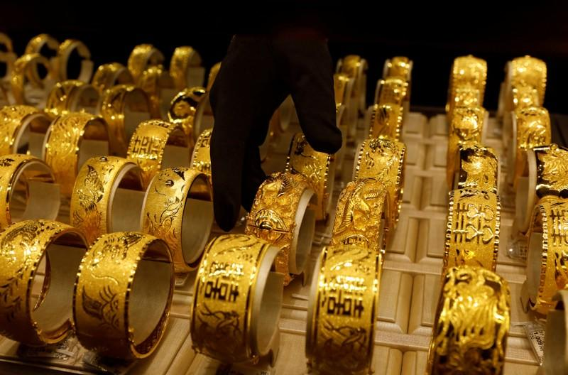 Gold eases as hopes of U.S.-China trade progress lift risk appetite