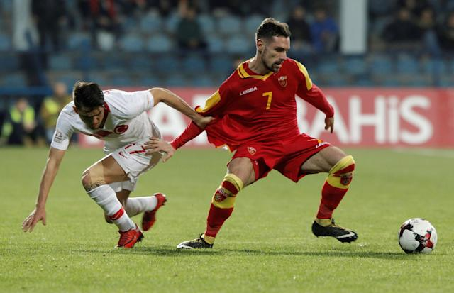 Soccer Football - International Friendly - Montenegro vs Turkey - Podgorica City Stadium, Podgorica, Montenegro - March 27, 2018 Montenegro's Marko Vesovic in action with Turkey's Cengiz Under REUTERS/Stevo Vasiljevic