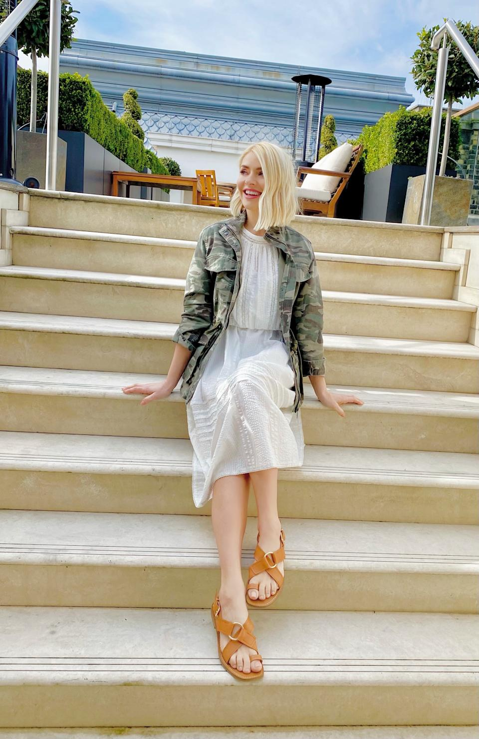 Holly Willoughby styles M&S' Pure Cotton Lace Trim Waisted Dress with a camouflage jacket and sandals for her first post-lockdown look.  (Marks and Spencer)