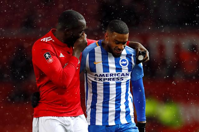 Soccer Football - FA Cup Quarter Final - Manchester United vs Brighton & Hove Albion - Old Trafford, Manchester, Britain - March 17, 2018 Manchester United's Romelu Lukaku with Brighton's Jurgen Locadia after the match Action Images via Reuters/Jason Cairnduff