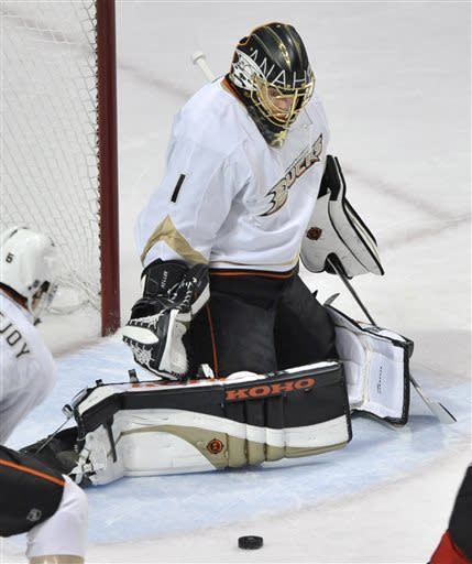 Anaheim Ducks goalie Jonas Hiller, of the Czech Republic, makes a save against the Chicago Blackhawks during the first period of an NHL hockey game in Chicago, Friday, March, 29, 2013. Anaheim won 2-1. (AP Photo/Paul Beaty)