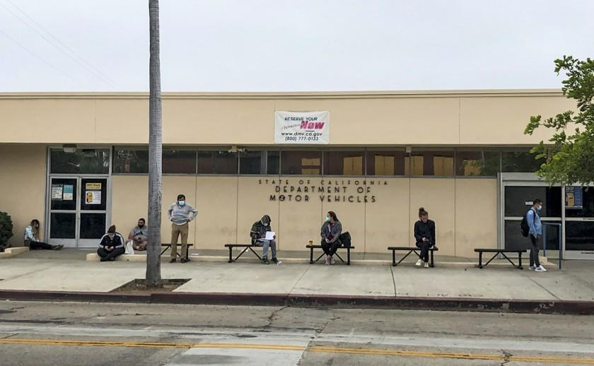 """People without appointments wait in line for the Hollywood DMV field office to open on July 16. <span class=""""copyright"""">(Adam Tschorn / Los Angeles Times)</span>"""