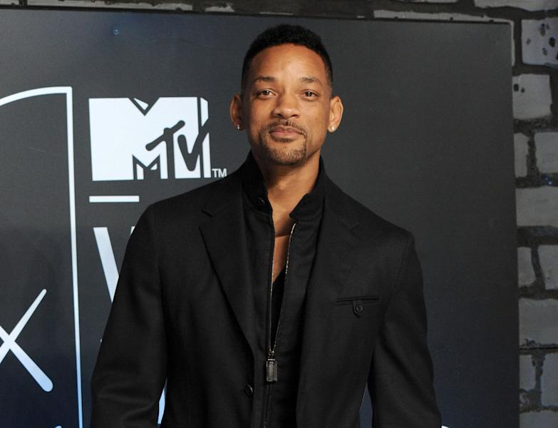 """FILE - This Aug. 25, 2013 file photo shows Will Smith at the MTV Video Music Awards at the Barclays Center in the Brooklyn borough of New York. NBC announced Monday, Feb. 10, 2014, that Will Smith will appear on the Feb. 17 debut of """"The Tonight Show Starring Jimmy Fallon."""" U2 will perform. Justin Timberlake will close out the week, which will also include appearances from Michelle Obama, Will Ferrell, Bradley Cooper, Kristen Wiig and Jerry Seinfeld. Lady Gaga, Arcade Fire and Tim McGraw will also perform during the week. (Photo by Evan Agostini/Invision/AP, File)"""