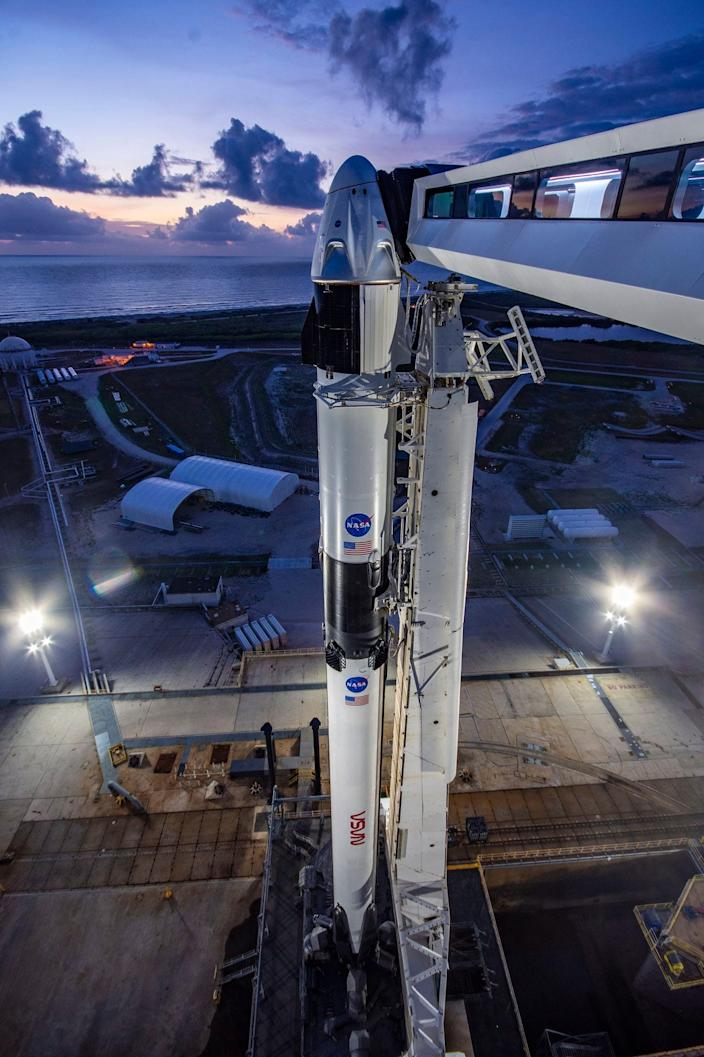 SpaceX's Crew Dragon spaceship and Falcon 9 rocket await launch from Cape Canaveral, Florida, at NASA's Kennedy Space Center on May 23, 2020.