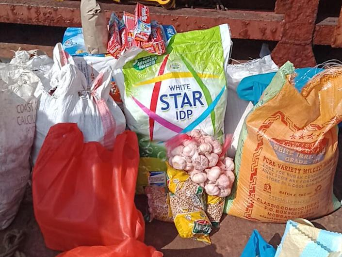 Several bags of food supplies on the deck of the MV Jinan, for the crew.