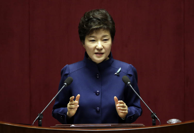 FILE - In this Nov. 18, 2013 file photo, South Korean President Park Geun-hye delivers a speech on the government budget at the National Assembly in Seoul, South Korea. A big question looms as the leaders of Japan and South Korea head to Europe next week: Will they finally meet? Friction over Japan's brutal colonization of Korea in the first half of the 20th century has prevented a summit between Japanese Prime Minister Shinzo Abe and South Korean President Park Geun-hye since they both took office more than a year ago. (AP Photo/Lee Jin-man, File)