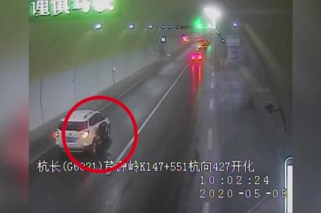 Man narrowly escapes being run over after dramatic car crash on Chinese expressway