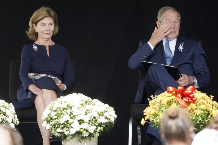 Former President George W. Bush, right, wipes his eyes next to former first lady Laura Bush, after he spoke at a memorial for the passengers and crew of United Flight 93, Saturday, Sept. 11, 2021, in Shanksville, Pa., on the 20th anniversary of the Sept. 11, 2001, attacks. (AP Photo/Jacquelyn Martin)