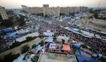 Thousands of Egyptians demanding the restoration of ousted Islamist president Mohamed Morsi had joined the protest camp in Cairo's Rabaa al-Adawiya Square which was bloodily broken up by troops and riot police