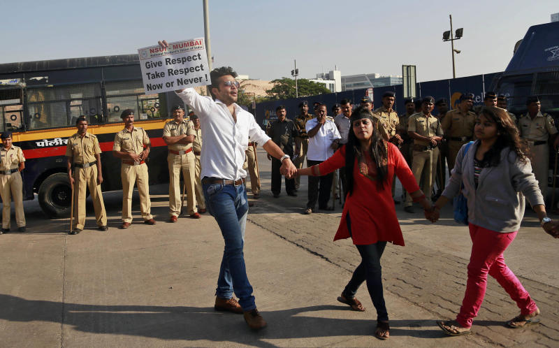 "Members of the National Students Union of India (NSUI), the student wing of India's ruling Congress party, participate in a protest outside the U.S. consulate in Mumbai, India, Friday, Dec. 20, 2013. India's Information Minister Manish Tewari lashed out at the United States on Friday and demanded an apology for the treatment and arrest of Devyani Khobragade, India's deputy consul general in New York, saying America cannot behave ""atrociously"" and get away with it. (AP Photo/Rafiq Maqbool)"