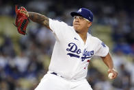 Los Angeles Dodgers starting pitcher Julio Urias throws during the first inning of a baseball game against the Atlanta Braves, Monday, Aug. 30, 2021, in Los Angeles. (AP Photo/Marcio Jose Sanchez)