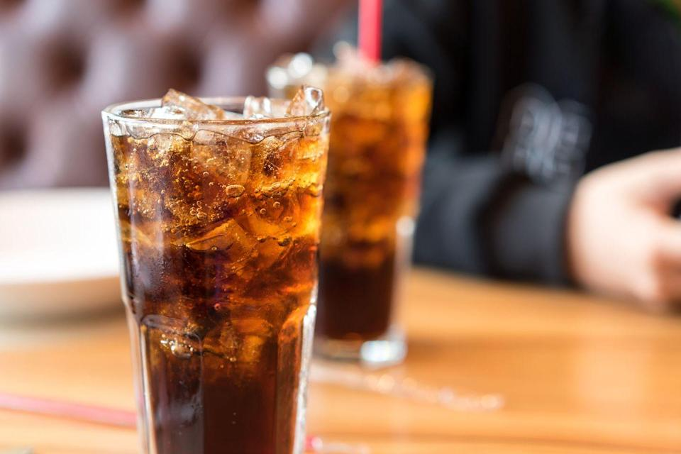"""<p>Speaking of sweet drinks, sugar-sweetened beverages make up about half of all added sugars in the average American's daily diet. For each additional sugar-packed drink, such as cola, you drink each day, you increase your risk for both heart disease and <a href=""""https://www.prevention.com/health/health-conditions/g27376679/reduce-risk-of-stroke/"""" rel=""""nofollow noopener"""" target=""""_blank"""" data-ylk=""""slk:stroke"""" class=""""link rapid-noclick-resp"""">stroke</a>, according to a <em><u><a href=""""https://www.ncbi.nlm.nih.gov/pubmed/23321486/"""" rel=""""nofollow noopener"""" target=""""_blank"""" data-ylk=""""slk:British Medical Journal"""" class=""""link rapid-noclick-resp"""">British Medical Journal</a></u></em> 2012 review. A <em>Journal of the American College of Cardiology </em><a href=""""http://dx.doi.org/10.1016/j.jacc.2018.05.030"""" rel=""""nofollow noopener"""" target=""""_blank"""" data-ylk=""""slk:meta-analysis"""" class=""""link rapid-noclick-resp"""">meta-analysis</a> found that frequent consumption of all sweetened drinks, including soda, faux fruit juices and sports drinks, makes you more likely to die of atherosclerosis.</p>"""