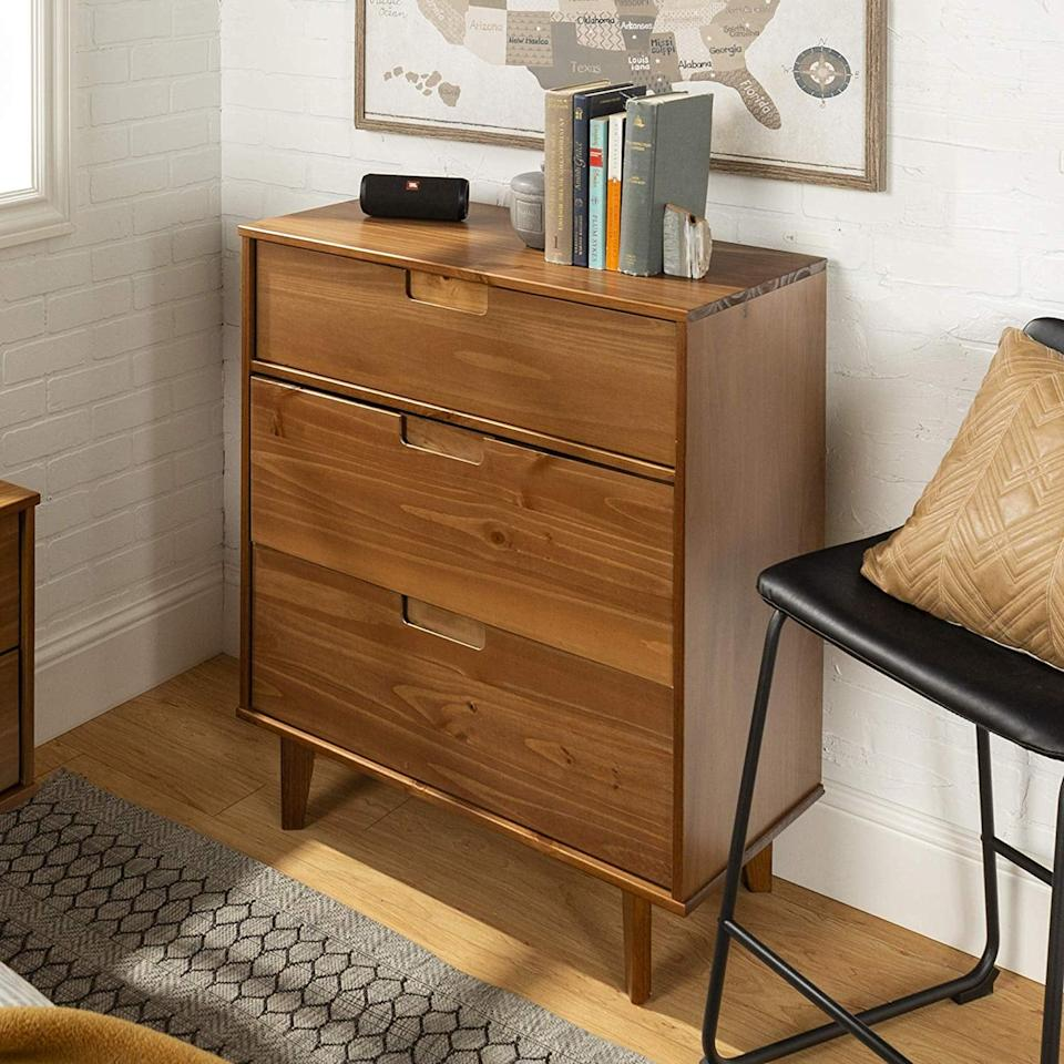 "<p>We love the style of this <a href=""https://www.popsugar.com/buy/WE%20Furniture%20Dresser-472015?p_name=WE%20Furniture%20Dresser&retailer=amazon.com&price=156&evar1=casa%3Aus&evar9=46417524&evar98=https%3A%2F%2Fwww.popsugar.com%2Fhome%2Fphoto-gallery%2F46417524%2Fimage%2F46417911%2FWE-Furniture-Dresser&list1=shopping%2Cfurniture%2Cbedrooms%2Chome%20shopping&prop13=mobile&pdata=1"" rel=""nofollow"" data-shoppable-link=""1"" target=""_blank"" class=""ga-track"" data-ga-category=""Related"" data-ga-label=""https://www.amazon.com/WE-Furniture-AZR3DSLDRCA-Dresser-Caramel/dp/B07N28F4BL/ref=sr_1_90?keywords=dressers+under+250&amp;qid=1563993930&amp;s=gateway&amp;sr=8-90"" data-ga-action=""In-Line Links"">WE Furniture Dresser</a> ($156, originally $199).</p>"