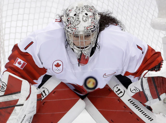 FILE - In this Feb. 22, 2018, file photo, goalie Shannon Szabados (1), of Canada, stares at the flying puck during the second period of the women's gold medal hockey game against the United States at the 2018 Winter Olympics in Gangneung, South Korea. More than 200 of the top female hockey players in the world have decided they will not play professionally in North America next season, hoping their stand leads to a single economically sustainable league. The announcement Thursday, May 2, 2019, comes after the Canadian Women's Hockey League abruptly shut down as of Wednesday, leaving the five-team, U.S.-based National Women's Hockey League as the only pro league in North America. The group of players, led by American stars Hilary Knight and Kendall Coyne Schofield and Canadian goaltender Shannon Szabados, hopes their move eventually pushes the NHL to start its own women's hockey league as the NBA did with the WNBA. (AP Photo/Matt Slocum, File)