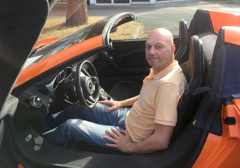 The undated photo provided by Hit Radio FFH shows Markus Zahn sitting in his sports car. The owner of a pricy McLaren sports car is in court to try to get a donkey owner to pony up for an alleged 5,000 euros (US$ 5,876) in damage caused when the animal chomped the backside of the vehicle. (Hit Radio FFH/dpa via AP) Mandatory Credit