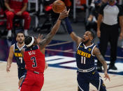 Denver Nuggets guard Monte Morris (11) steals the ball from Washington Wizards guard Bradley Beal (3) during the second quarter of an NBA basketball game Thursday, Feb. 25, 2021, in Denver. (AP Photo/Jack Dempsey)