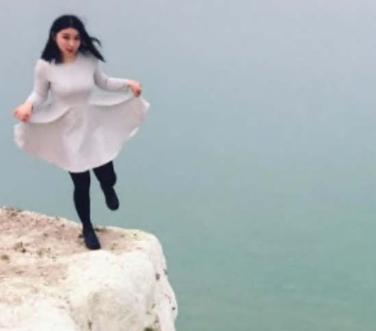 Balanced: One girl stood on one leg at the edge of the cliff (Instagram)