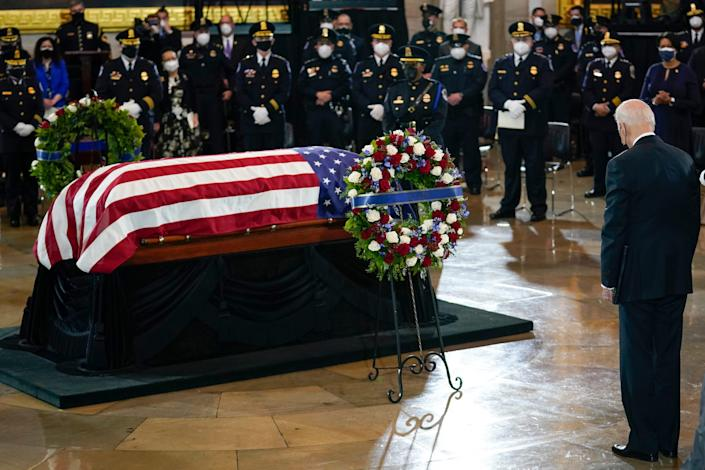 U.S. President Joe Biden pays respects to the late Capitol Police officer William Evans as he lies in honor.