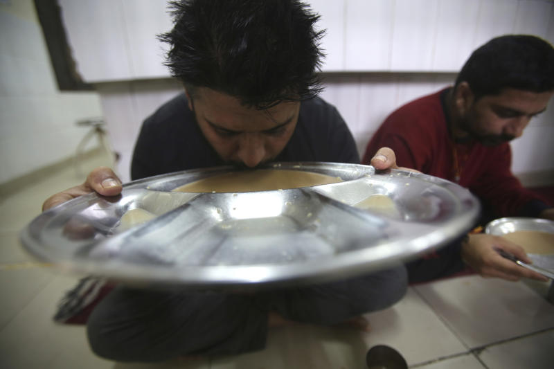 In this Thursday, Oct. 31, 2019, photo, recovering drug addicts eat a meal at a de-addiction center in Kapurthala, in the northern Indian state of Punjab. India has twice the global average of illicit opiate consumption. Researchers estimate 4 million Indians use heroin or other opioids, and a quarter of them live in the Punjab, India's agricultural heartland bordering Pakistan, where some of the most vulnerable are driven to drugs out of desperation. (AP Photo/Channi Anand)