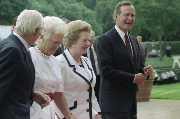 <p>President George H.W. Bush, right, and first lady Barbara Bush, second from right, escort British Prime Minister Margaret Thatcher, second from left, and her husband, Denis Thatcher, left, to the first meeting of the Economic Summit at Rice University, on July 9, 1990, Houston, Texas. (Photo: Koji Sasahara/AP) </p>