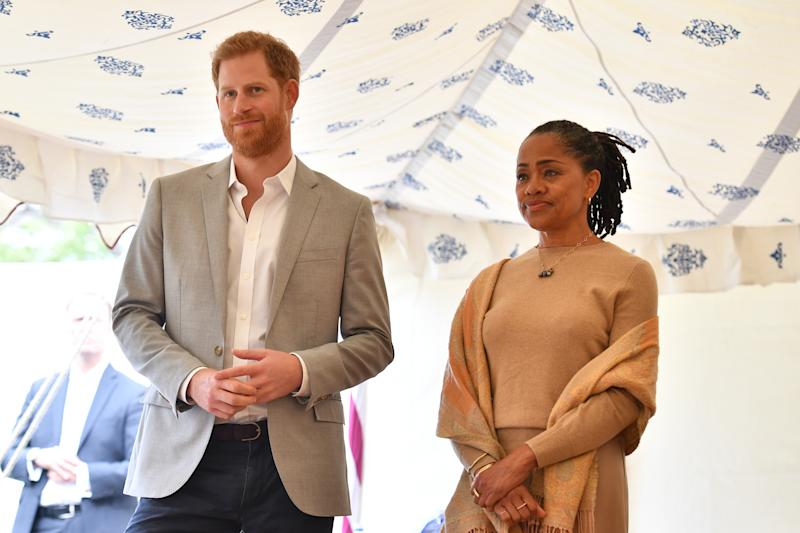 Prince Harry, Duke of Sussex and Doria Ragland listen to Meghan, Duchess of Sussex speaking at an event to mark the launch of a cookbook with recipes from a group of women affected by the Grenfell Tower fire at Kensington Palace on September 20, 2018 in London, England.
