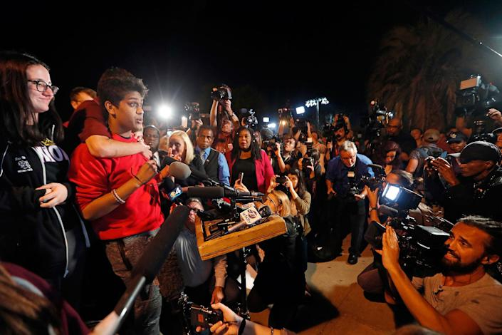 <p>Tanzil Philip, 16, a student survivor from Marjory Stoneman Douglas High School, where 17 students and faculty were killed in a mass shooting on Wednesday, speaks to a crowd of supporters and media as they arrive at Leon High School, in Tallahassee, Fla., Tuesday, Feb. 20, 2018. The students arrived in the state's capital to talk to legislators and rally for gun control reform. (Photo: Gerald Herbert/AP) </p>