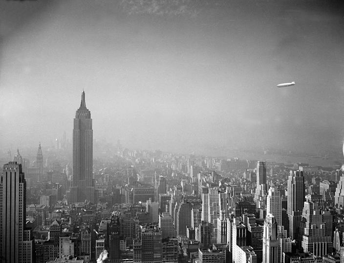 <p>The German-built zeppelin Hindenburg, right, floats over the Manhattan skyline on Aug. 8, 1936. The Empire State Building, measuring 1,250 feet in height, can be seen at left. (AP Photo) </p>