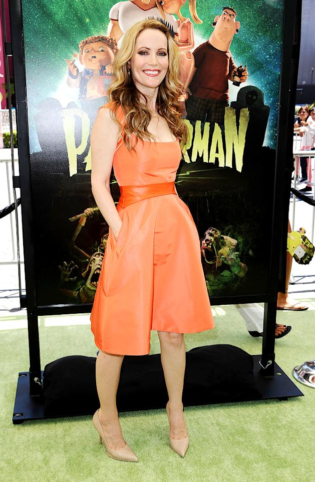 "She may not be the biggest star in Hollywood, but Leslie Mann never fails to impress -- in the fashion department -- at any of her movie premieres. The 40 year old -- who voices Norman's mother in ""ParaNorman"" -- popped a pose in a peachy keen Monique Lhuillier design when she arrived at the film's L.A. debut on Sunday. A bright smile, two-tone tresses, and nude Givenchy heels completed her flawless look. (8/5/2012)"