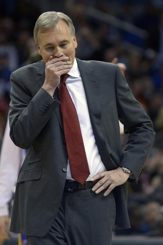 Los Angeles Lakers head coach Mike D'Antoni reacts during a timeout in the second half of an NBA basketball game against the Orlando Magic in Orlando, Fla., Friday, Jan. 24, 2014. The Magic won 114-105. (AP Photo/Phelan M. Ebenhack)