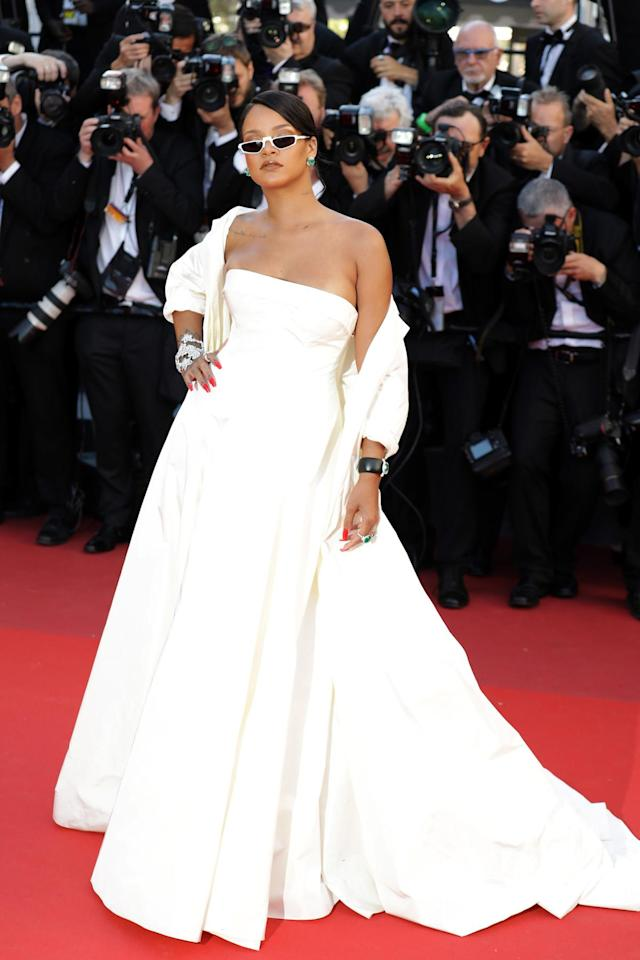<p>Rihanna fittingly channeled Princess Grace of Monaco in a strapless Dior gown with a matching shawl for the premiere of <em>Okja</em>. However it was the personal details, including Chopard jewels and '90s sunglasses, that made the ensemble fit for a modern-day pop queen such as herself. (Photo: Giulio Origlia/Getty Images) </p>