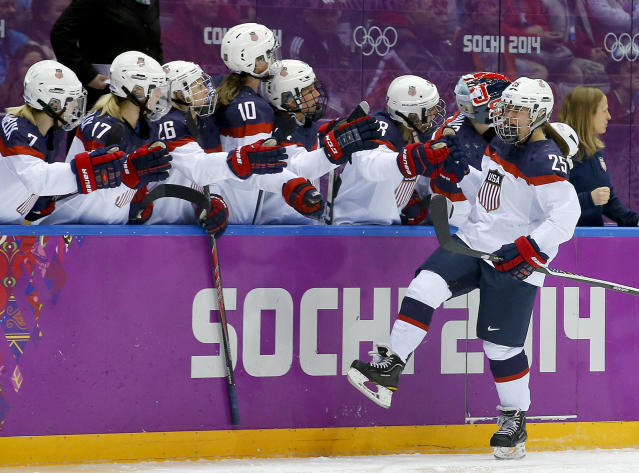 Alex Carpenter of the United States (25) celebrates with teammates after scoring a goal against Canada during the third period of the women's gold medal ice hockey game at the 2014 Winter Olympics, Thursday, Feb. 20, 2014, in Sochi, Russia. (AP Photo/Matt Slocum)