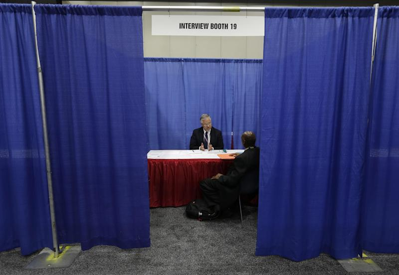 A military veteran receives a job interview in Detroit, Tuesday, June 26, 2012. Thousands of veterans are in Detroit this week for a job fair, open house, and small business conference. (AP Photo/Paul Sancya)