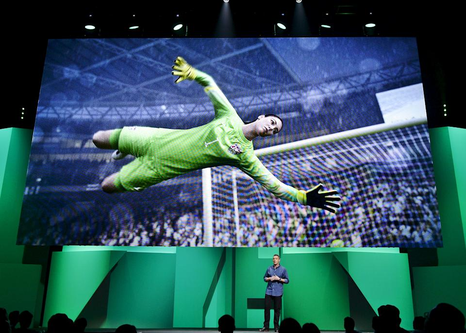 "United State national soccer team's goalkeeper Hope Solo's image is shown on the screen as David Rutter, vice president and general manager of EA Sports FIFA, introduces the video game ""FIFA 16"" during Electronic Arts media briefing before the opening day of the Electronic Entertainment Expo, or E3, at the Shrine Auditorium in Los Angeles, California June 15, 2015.   REUTERS/Kevork Djansezian"