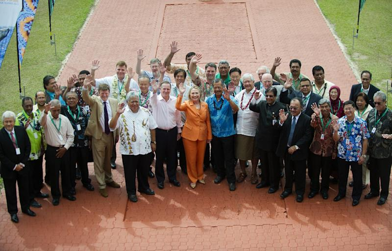U.S. Secretary of State Hillary Clinton, center, waves with other Pacific Island leaders while posing for the family photo during the Pacific Island Forum Post-Forum Dialogue in Rarotonga, Cook Islands, Friday, Aug. 31, 2012. (AP Photo/Jim Watson, Pool)