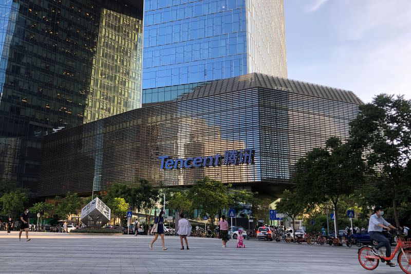 FILE PHOTO: People are seen in front of the Tencent company headquarters in Shenzhen
