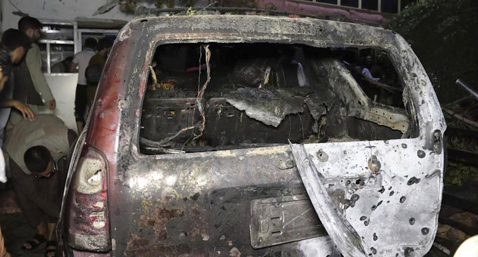 A destroyed vehicle inside a home after the airstrike. Source: AP