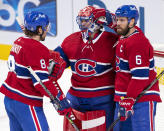 Montreal Canadiens goaltender Carey Price (31) is congratulated by Ben Chiarot (8) and Shea Weber (6) after the team's win over the Ottawa Senators in an NHL hockey game Tuesday, March 2, 2021, in Montreal. (Ryan Remiorz/The Canadian Press via AP)