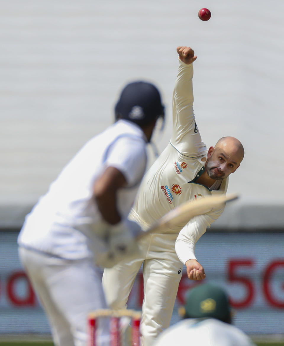 Australia's Nathan Lyon bowls during play on day three of the second cricket test between India and Australia at the Melbourne Cricket Ground, Melbourne, Australia, Monday, Dec. 28, 2020. (AP Photo/Asanka Brendon Ratnayake)